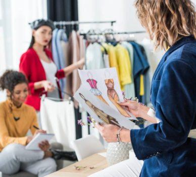 Fashion Designer With Sketches